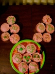 "From X.F. ""I made cupcakes for Barnaby with pink icing and green decorations on some (letters, a picture of a bunny, etc). And then arranged them to try to make it look like bunny ears."""