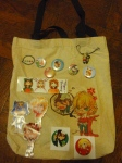 """From Anonymous. """"This is the collection of fanmade swag I bought at New York Comic Con this October (minus a few posters). If forced to pick, the pair of Kotetsu & Barnaby charms in the top right would have to be my fave. I attach them to my 3DS!"""""""